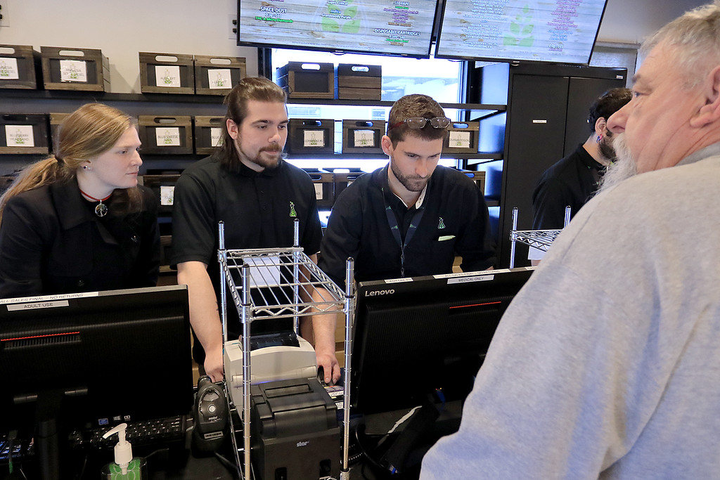 . Sanctuary Medicinals in Gardner has been open for medical sales since November 23, 2018. On Wednesday March 6, 2019 they opened for recreational sales. Employees Alex Twomey, Brad Geslak and manager Dave Shibley check out Ken Walker of Fitchburg their first recreational customer. SENTINEL & ENTERPRISE/JOHN LOVE