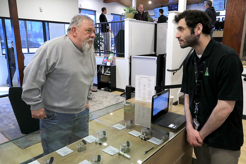 Sanctuary Medicinals in Gardner has been open for medical sales since November 23, 2018. On Wednesday March 6, 2019 they opened for recreational sales. Ken Walker of Fitchburg their first recreational customer works with Sanad Ishtiwi as he tries to decide which strain of cannabis he wanted. SENTINEL & ENTERPRISE/JOHN LOVE