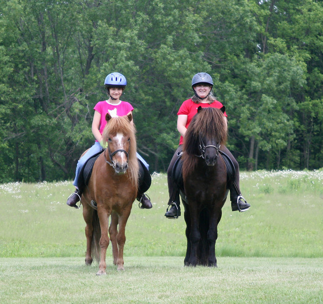 Kestrel riding Kraftur and Andrea riding Hrokur  - Sand Meadow Farm<br>June 2011
