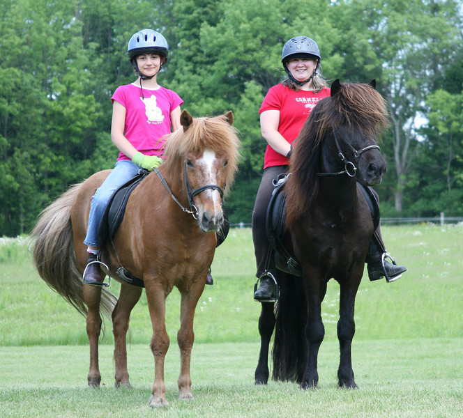 Kestrel riding Kraftur and Andrea riding Hrokur Sand Meadow Farm  June 2011 (<i>photo:  Steven Barber</i>)