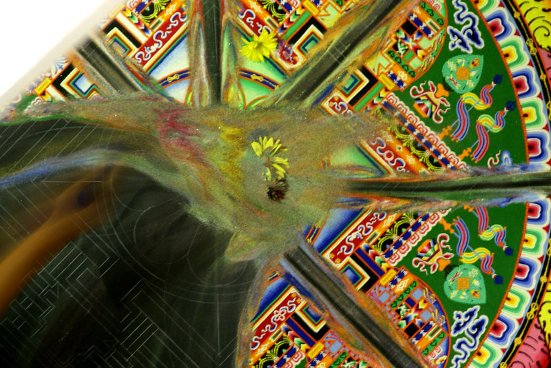 """2007 - As part of the closing ceremony, the mandala is dismantled by sweeping away the sands.  This ritual act serves as a reminder of the impermanence of life.<br /> <br /> Click on the link below for audio comments by Juana Clem McGhee.<br /> <a href=""""http://mesas.emory.edu/home/documents/audio/15JMcGhee.mp3"""">http://mesas.emory.edu/home/documents/audio/15JMcGhee.mp3</a>"""