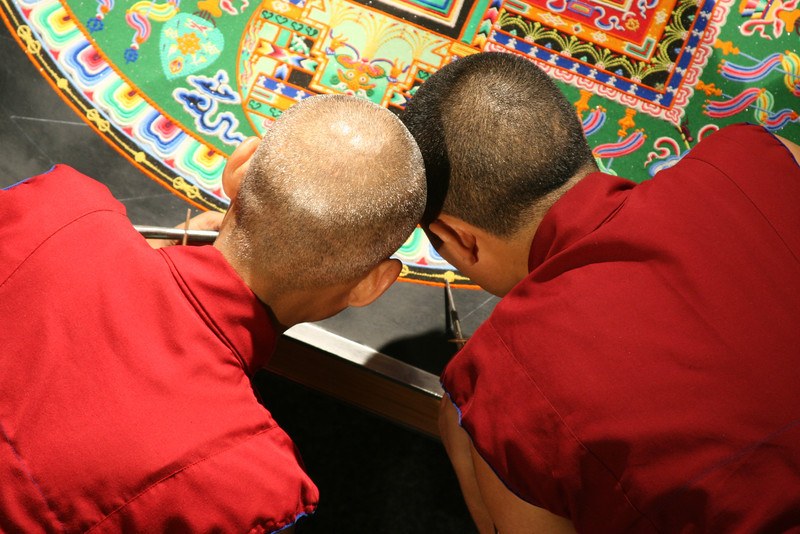 """2007 - The monks often work in close proximity to one another, as seen here, head to head.  This sort of proximity can represent to us a true meeting of the minds.<br /> <br /> Click on the link below for audio comments by Juana Clem McGhee.<br /> <a href=""""http://mesas.emory.edu/home/documents/audio/10JMcGhee.mp3"""">http://mesas.emory.edu/home/documents/audio/10JMcGhee.mp3</a>"""