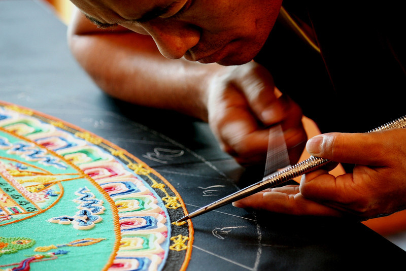 """2010 - The mind of the monk is focused on the artistic elements of creating the mandala, while at the same time, meditating on healing the earth and its inhabitants.<br /> <br /> Click on the link below for audio comments by Juana Clem McGhee.<br /> <a href=""""http://mesas.emory.edu/home/documents/audio/11JMcGhee.mp3"""">http://mesas.emory.edu/home/documents/audio/11JMcGhee.mp3</a>"""