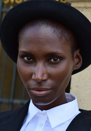 This beauty was walking at the Louvre and I asked her to pose briefly for some street portraits.  She was a Haitian born New Yorker.