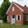 The brick schoolhouse was built in 1868. The first school on the site was wooden and dates to 1792.