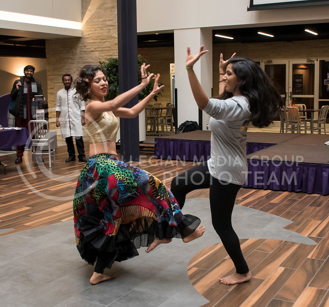Swarali Karulkar demonstrates an Indian dance move with a participating student of Sanskriti, organized by the Indian Students Association at the Kansas State Student Union Courtyard in Manhattan, KS, on Nov. 4, 2017. (Olivia Bergmeier | Collegian Media Group)
