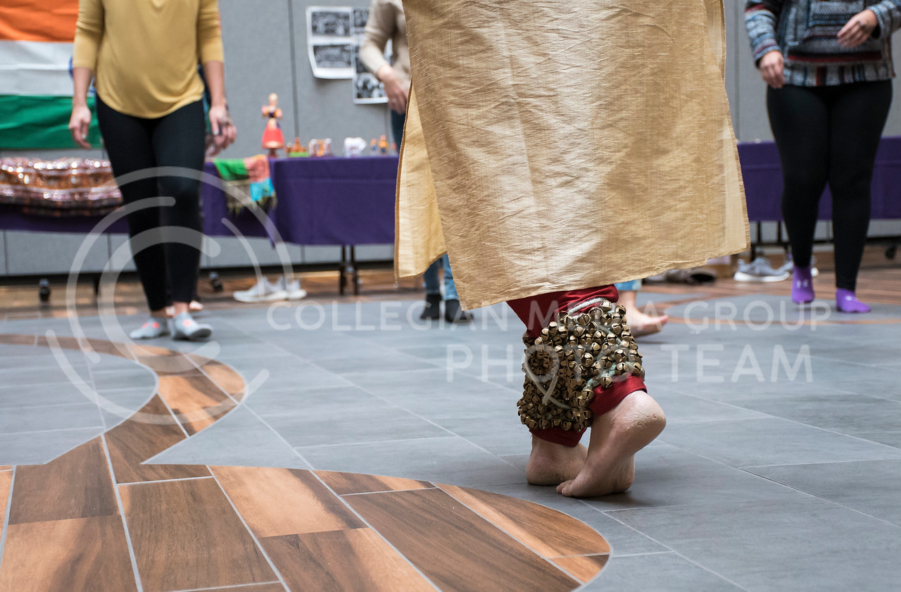 A performer at Sanskriti, organized by the Indian Students Association, shows students how to dance with Ghungrus Feetbells for an Indian Dance Workshop in the Kansas State Student Union Courtyard in Manhattan, KS, on Nov. 4, 2017. (Olivia bergmeier | Collegian Media Group)