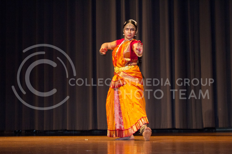 Ankita Saha, post-doctoral researcher at the University of Illinois at Urbana-Champaign, performed traditional steps to a blend of traditional and contemporary music at Sanskriti on Nov. 4, 2017. (Tiffany Roney | Collegian Media Group)