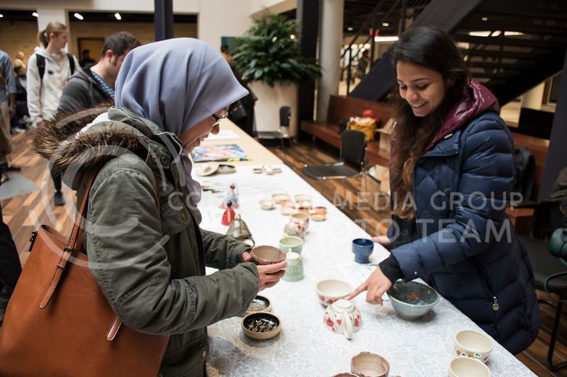 A participant in Sanskriti discusses traditional Indian pottery with a member of the Indian Students Association in the Kanasas State Student Union in Manhattan, KS, on Nov. 4, 2017. (Olivia Bergmeier | Collegian Media Group)