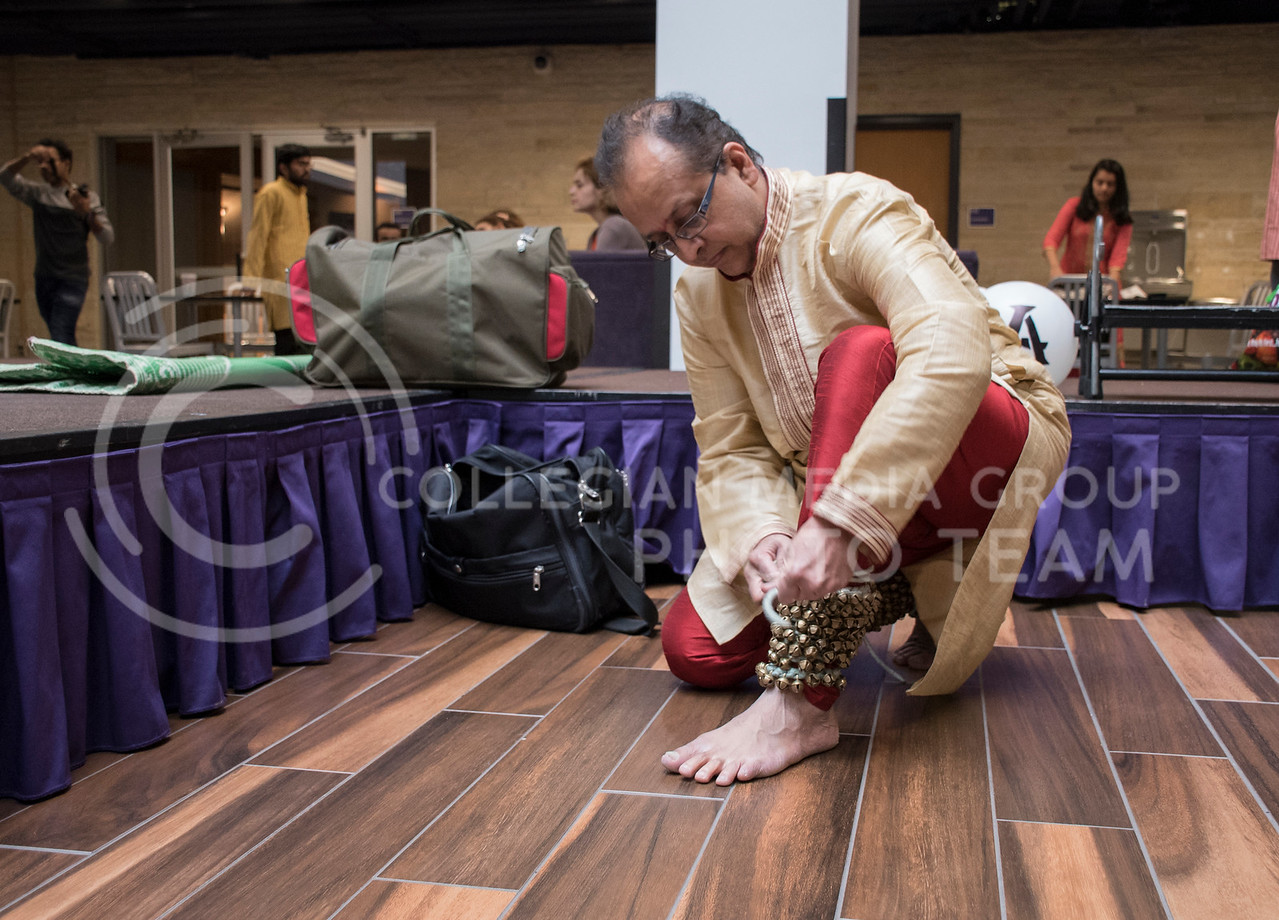 A performer at Sanskriti, organized by the Indian Students Association, adorns his ankles with Ghungrus Feetbells for an Indian Dance Workshop in the Kansas State Student Union Courtyard in Manhattan, KS, on Nov. 4, 2017. (Olivia bergmeier | Collegian Media Group)