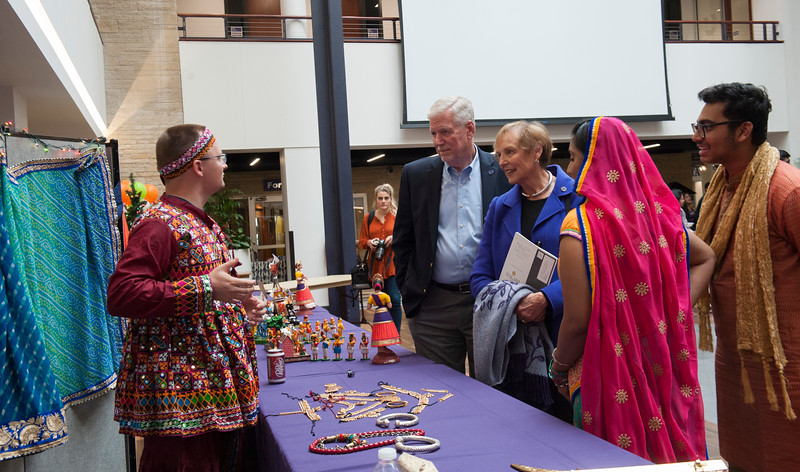 President Richard B. Myers receives a tour of the Sanskriti 2018 event at the Kansas State University Student Union on Nov. 3, 2018. Sanskriti is a Indian cultural inclusion event put on by Indian Students Association to promote learning about thier culture and traditions. (Photo by Justin Wright | Collegian Media Group)
