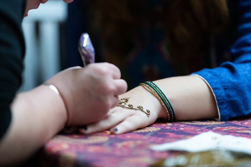 A girl gets a Henna tattoo on her hand during Sanskriti in the Union courtyard on November 3, 2018. (Alex Todd | Collegian Media Group)