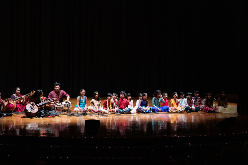 Accompanied by a sitar and drums, a group of local children sing a classical Indian song during Sanskriti in Forum Hall on November 3, 2018. (Alex Todd | Collegian Media Group)
