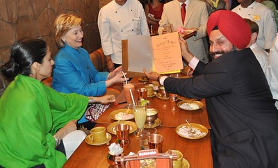 Sant Chatwal Chairman Indian American Democrats Presenting Hillary Platter in menu  to Secretary of State Hillary Clinton at BUKRA in ITC Murya in Delhi on 19th july-09...pic Mohammed Jaffer-SnapsIndia