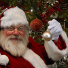 Santa Claus holding Christmas Ball Picture