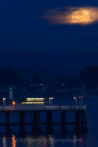 Snow Moon rising over Santa Cruz Wharf