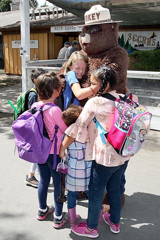 . School kids line up for a bear hug from Smokey at the Santa Cruz County Fair on Thursday. (Dan Coyro -- Santa Cruz Sentinel)