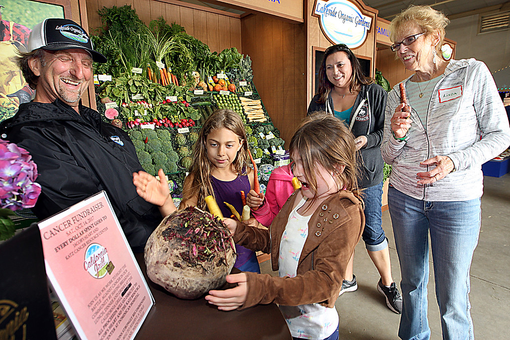 . Bay View Elementary students are stunned by the basketball-sized beet exhibited by Daryl Wise of Lakeside Organic Gardens at the Santa Cruz County Fair on Thursday. (Dan  Coyro -- Santa Cruz Sentinel)