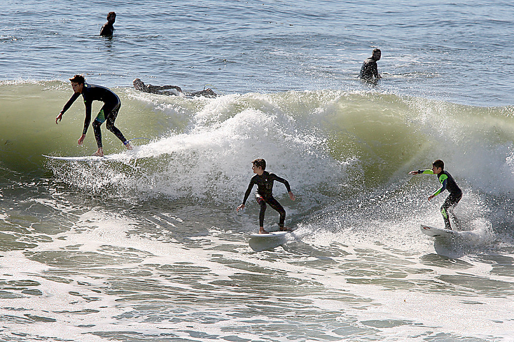 . A young surfer, left, drops in on a younger surfer who is burning a smaller kid on a Steamer Lane wave as the first decent-sized swell in months rolled into the Central Coast on Friday, Oct. 6, 2017. (Dan  Coyro -- Santa Cruz Sentinel)