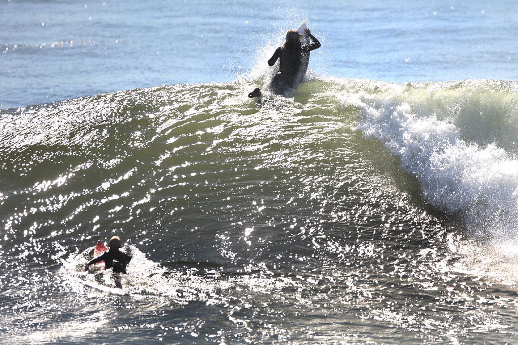 . A surfer scrambles over the top of a breaking wave at Steamer Lane on the morning of Friday, Oct. 6, 2017. (Dan  Coyro -- Santa Cruz Sentinel)