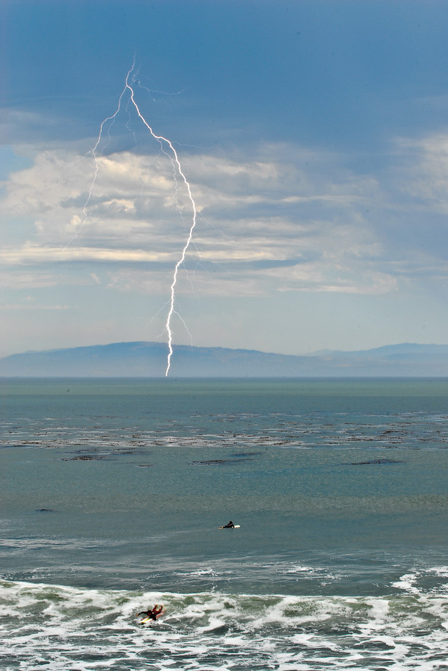 There was a rare thunderstorm over Monterey bay. We took a walk down 38th while the rain beat away the 100 degree heat and found that the surfers are crazy enough to keep surfing even with lightning around!!