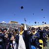 Graduates throw their caps in the air at the Santa Fe High School graduation on Friday, May 26, 2017. Luis Sánchez Saturno/The New Mexican