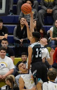 Semifinals of the Capital City Invitational boys basketball game between the Santa Fe High School and Santa Teresa High School played at Toby Roybal Memorial Gymnasium, Santa Fe High, Friday, December 9, 2016. Clyde Mueller/The New Mexican