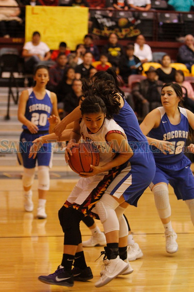 Santa Fe Indian School's Leanna Lewis, number 10, gets a rebound away from Socorro's Zoe Esquivel, number 14, during the first quarter of the Santa Fe Indian School vs Socorro High School at Santa Fe Indian School on Friday, Mar 2, 2018. Luis Sánchez Saturno/The New Mexican
