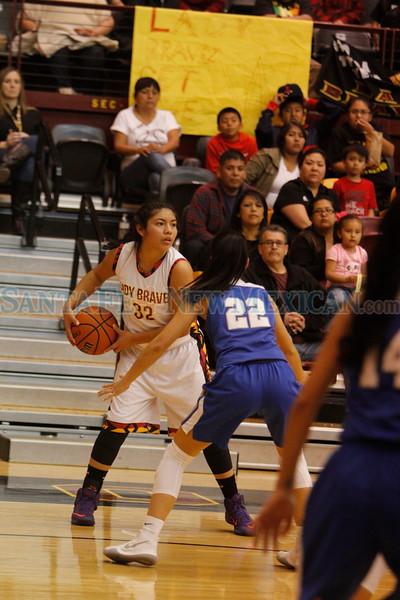Socorro's Kaylene Baca, number 22, covers, Santa Fe Indian School's Camilla Lewis, number 32, during the second quarter of the Santa Fe Indian School vs Socorro High School at Santa Fe Indian School on Friday, Mar 2, 2018. Luis Sánchez Saturno/The New Mexican