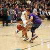 Manzano's Roman Romero, number 22, covers Santa Fe's Cruz Martinez, number 3, while he recovers a loose ball during the first quarter of the Santa Fe High School vs Manzano High School at Capital High School on Monday, February 25, 2019. Luis Sánchez Saturno/The New Mexican