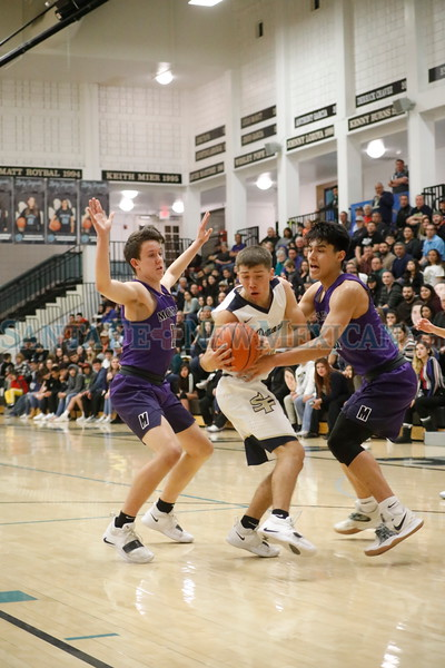 Manzano's , Jack Kalivoda, number 10, and Tyler Allen, number 33, double team Santa Fe's Antonio Lovato, number 11, during the second quarter of the Santa Fe High School vs Manzano High School at Capital High School on Monday, February 25, 2019. Luis Sánchez Saturno/The New Mexican