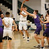 Manzano's Jack Blankenship, number 14, covers Santa Fe's Antonio Lovato, number 11, while he looks for the open man during the second quarter of the Santa Fe High School vs Manzano High School at Capital High School on Monday, February 25, 2019. Luis Sánchez Saturno/The New Mexican
