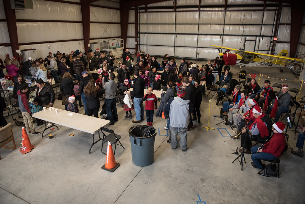 . The hanger at the Fitchburg Municipal Airport is filled with families who want to visit Santa Claus after he lands by Helicopter on Sunday Dec. 10, 2017.  SENTINEL & ENTERPRISE JEFF PORTER