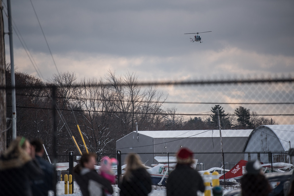 . A helicopter carrying Santa Claus flies into Fitchburg Municipal Airport on Sunday Dec. 10, 2017  SENTINEL & ENTERPRISE JEFF PORTER