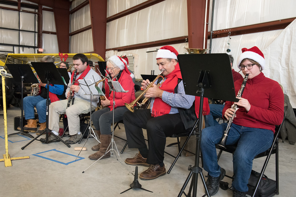 . The Nashoba Valley orchestra plays Christmas tunes at the Fitchburg Municipal Airport on Sunday Dec. 10, 2017.  SENTINEL & ENTERPRISE JEFF PORTER