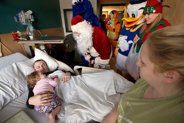 Members of the Fort Lee Police Department visited Emily Tankard, and other children, in the pediatrics department of Holy Name Medical Center to give out presents for the holidays. <br /> <br /> Photo by Jeff Rhode / Holy Name Medical Center 12/20/13