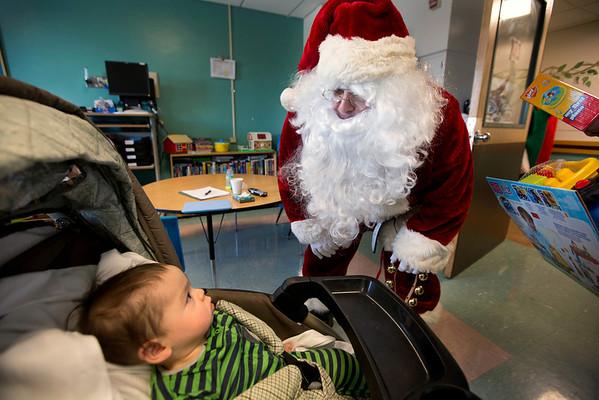 Members of the Fort Lee Police Department visited children in the pediatrics department of Holy Name Medical Center to give out presents for the holidays. <br /> <br /> Photo by Jeff Rhode / Holy Name Medical Center 12/20/13