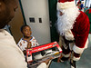 Members of the Fort Lee Police Department visited Terrell Duncan, and other children, in the pediatrics department of Holy Name Medical Center to give out presents for the holidays. <br /> <br /> Photo by Jeff Rhode / Holy Name Medical Center 12/20/13
