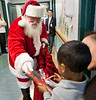 Santa Clause visited the Pediatrics department of Holy Name Medical Center in Teaneck to give presents to the children.<br /> Photo by Jeff Rhode / Holy Name Medical Center 12/18/13