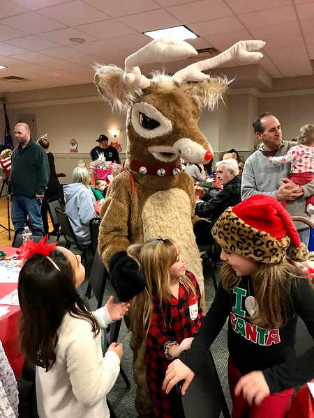 Rudolph the reindeer delighted children at the breakfast with Santa. Photo by Mary Leach