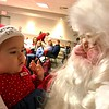 Catherine Demonico, age 8 months, seemed fascinated with Santa's beard. Photo by Mary Leach
