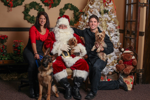 Maggie, Adam and doggy family with Santa
