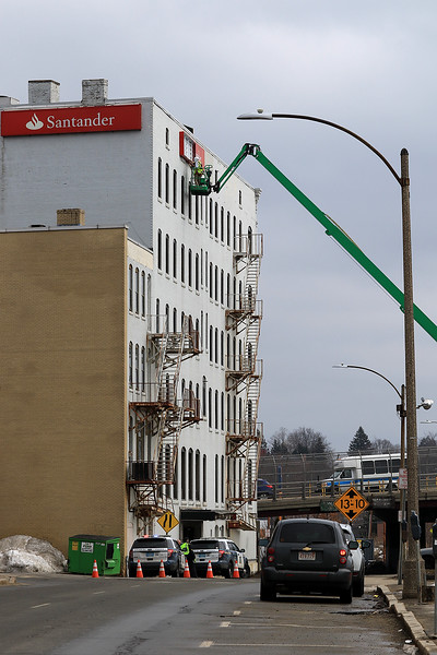 On Friday afternoon Lauretano Sign Group out of Connecticut was taking down the Santander Bank signs on their building that sits between main street and Boulder Drive in Fitchburg. the sign where coming down on the Boulder Drive side because they are moving to 147 Water Street in the City. SENTINEL & ENTERPRISE/JOHN LOVE