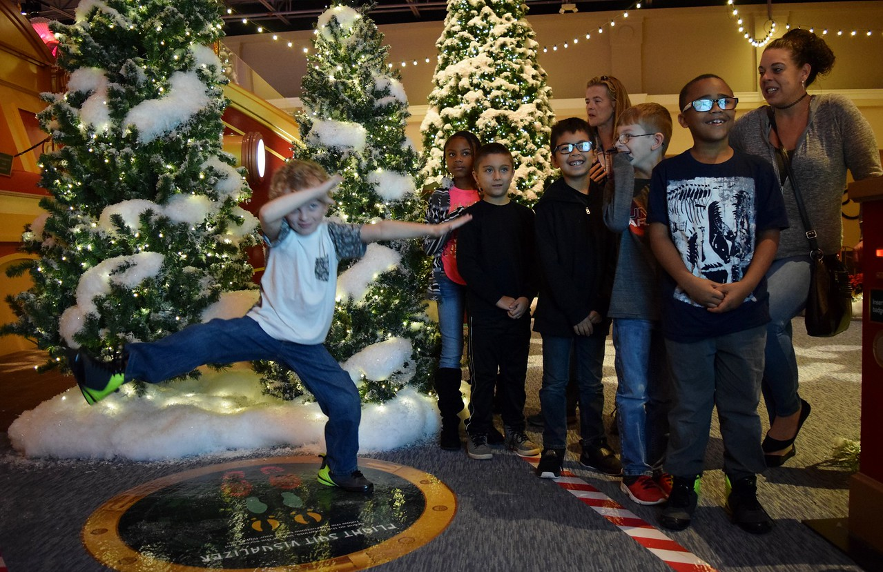 Sixty kids from Auburn Elementary in Auburn Hills walk through the Santa's Flight Academy at Great Lakes Crossing Outlets on Thursday, Nov. 9, 2017.