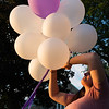 Ashley Decoteau prepares balloons to be released at the conclusion of a vigil held in Monument Square for murder victim Corinna Santiago. SENTINEL&ENTERPRISE/ Jim Marabello