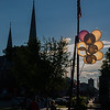 Balloons back lit by the sun are tied off to a post in Monument Square at a vigil for Leominster murder victim Corinna Santiago. SENTINEL&ENTERPRISE/ Jim Marabello