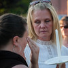 Sophia Leeman (right) sister of murder victim Corinna Santiago comforts Santiago's best friend Charlotte Waitkus at a vigil held in Monument Square. SENTINEL&ENTERPRISE/ Jim Marabello
