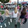 Friends and family of murder victim Corinna Santiago prepare to light candles at a vigil held for her in Monument Square. SENTINEL&ENTERPRISE/ Jim Marabello