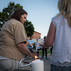 Virginia Santiago (left) and Sophia Leeman (right) mother and sister of murder victim Corinna Santiago light candles at a vigil held in Monument Square. SENTINEL&ENTERPRISE/ Jim Marabello