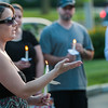 Vikki Tuck speaks about Corinna Santiago at a vigil held for the murder victim in Monument Square. SENTINEL&ENTERPRISE/ Jim Marabello